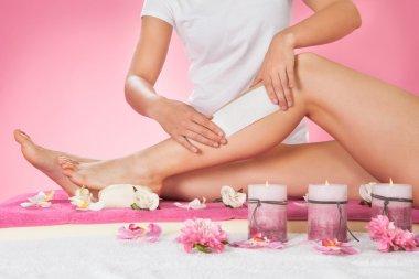 Therapist Waxing Leg