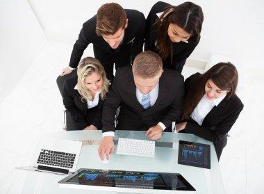 Businesspeople Using Desktop PC