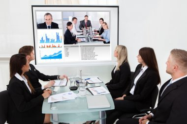 Businesspeople Looking At Projector Screen
