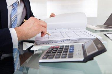 Businessman Calculating Expense