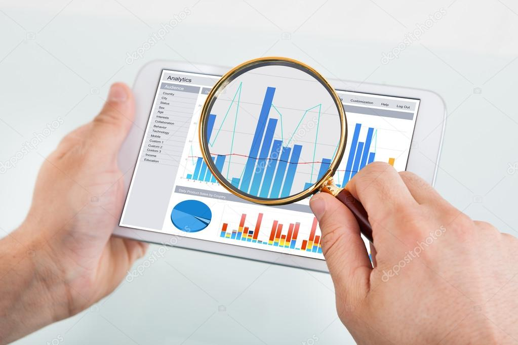 Businessman with Graph On Digital Tablet