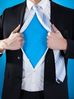 Superhero Businessman Tearing Suit