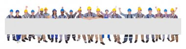 Successful Manual Workers With Blank Billboard