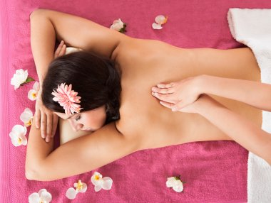 Woman Receiving Back Massage At Beauty Spa