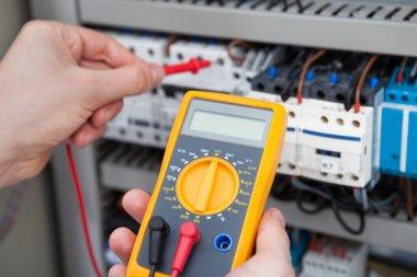 Electrician Examining Fusebox