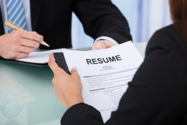 Female Candidate Holding Resume