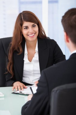 Businesswoman Interviewing Male Candidate