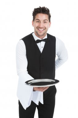 Young Waiter Holding Empty Serving Tray