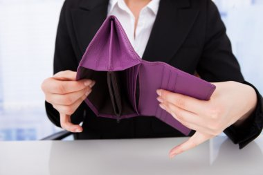 Businesswoman Holding Empty Wallet
