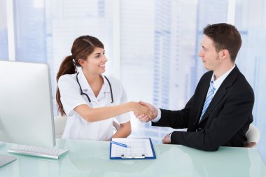 Doctor Greeting Businessman