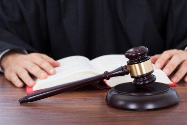 Judge Reading Law Book
