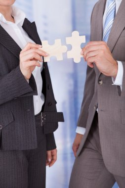 Business People Joining Jigsaw