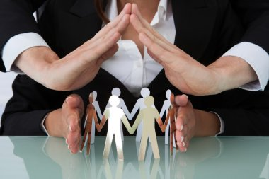 Business People Sheltering Team