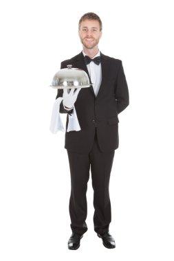 Waiter Holding Domed Tray