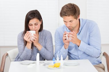 Sick Couple Drinking  Tea