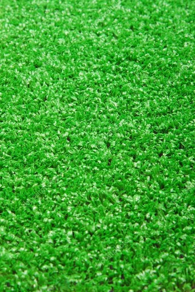 Artificial grass astroturf closeup background