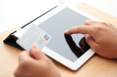 Tablet online shopping with credit card