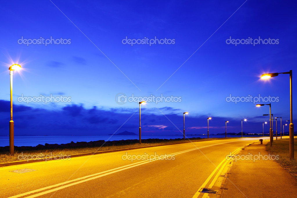 Empty asphalt road at night