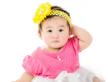 Asian baby girl scratching her head
