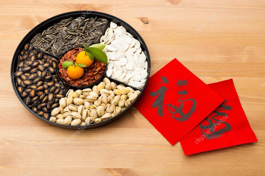 Assorted chinese sytle snack tray and chinese calligraphy