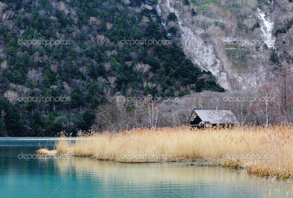 Beatiful lake with wooden house