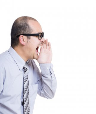 Side profile portrait of businessman shouting