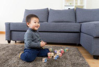 Asia little boy play toy block