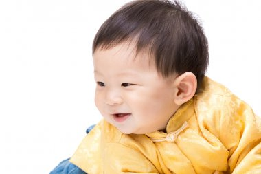 Chinese baby boy looking aside