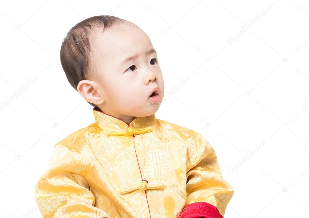 K Chenpantry baby boy in traditional costume looking aside stock photo leungchopan 43369685