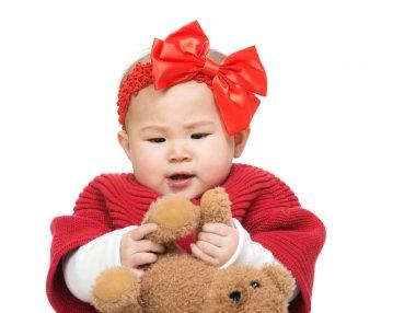 Little girl play with bear