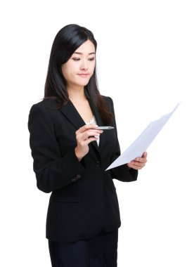 Asian business woman look at information on paper