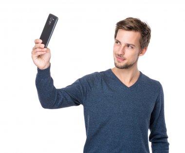 Caucasian man take selfie