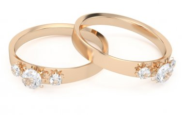 two gold rings with diamonds
