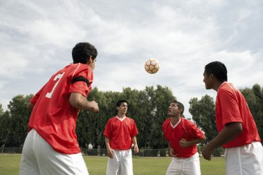 Footballers Heading The Ball