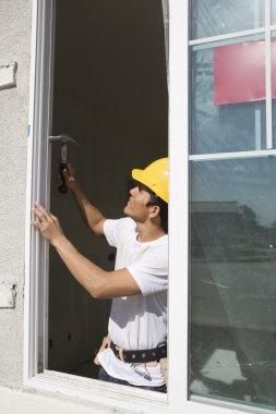 Architect Installing New Window