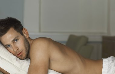 Shirtless Man Lying In Bed