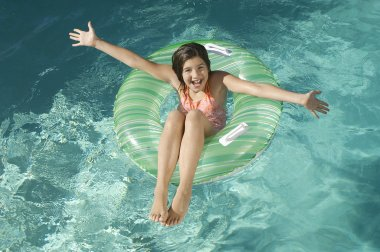 Little Girl On Inflatable Ring With Arms Outstretched