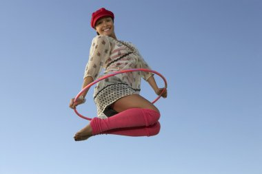 Woman Jumping With Hula Hoop