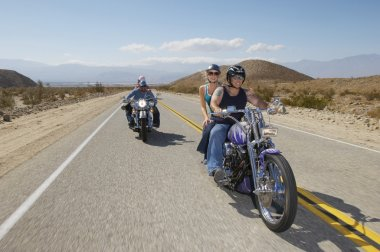 Bikers Riding On Country Road