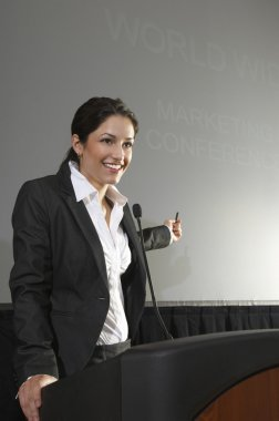 Businesswoman Giving A Lecture At Podium