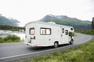 USA, Alaska, Recreational Vehicle Driving On Road