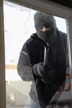 Masked Thief Breaking Glass