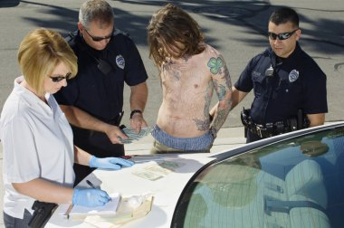 Police Officers Arresting Young Man