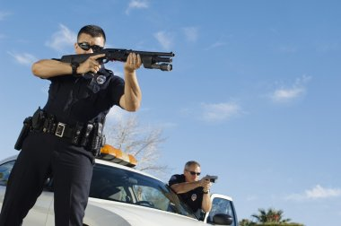 Police Officer Aiming Shotgun