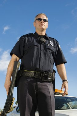 Police Officer Holding Weapon