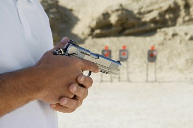 Midsection Of A Man holding Hand Gun