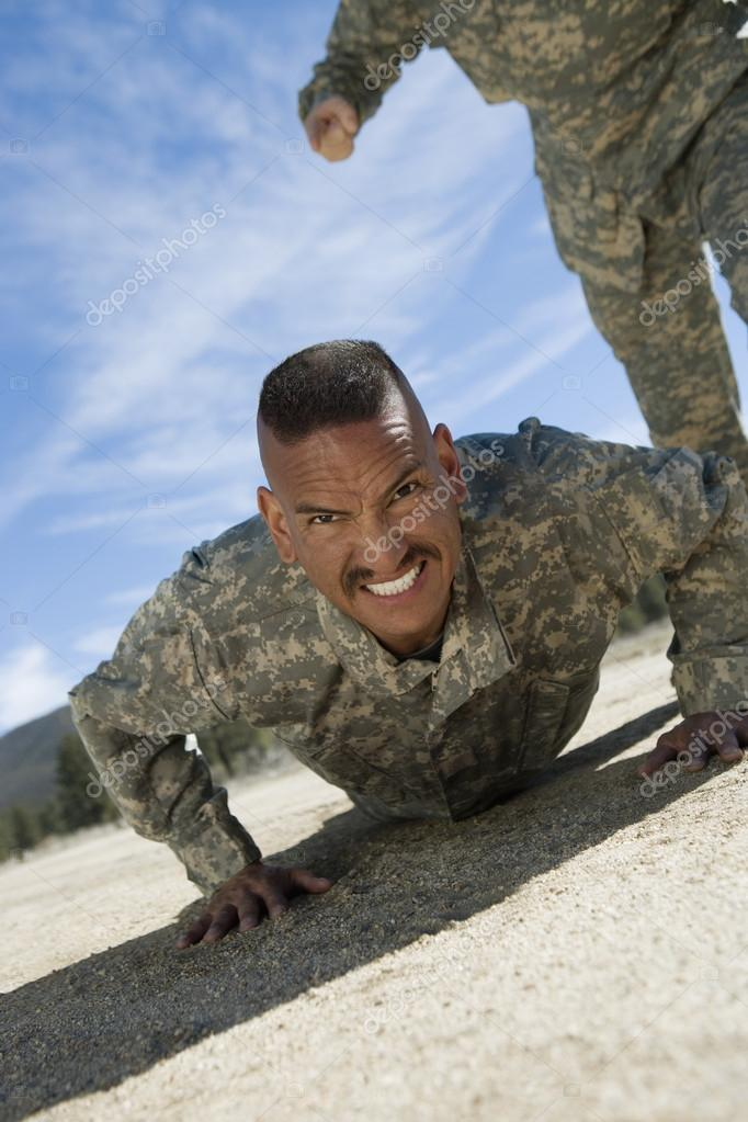 Portrait of male soldier doing pushups during training