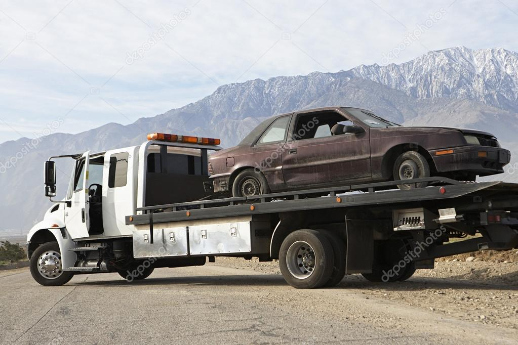 Broken Car On Tow Truck