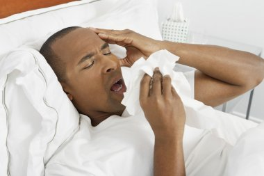Man With Flu In Bed