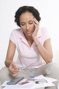 Woman Looking At Credit Cards